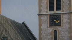 Close view of the clock on Sacred Heart Cathedral's tower in Sarajevo - stock footage