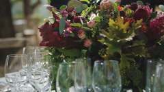 Wine Glasses and  Flowers on Dining Table at Wedding - stock footage