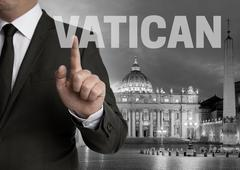 Vatican skyline at night with businessman concept Stock Photos