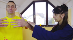 Martial arts teacher showing learner forms of Kung Fu close-up 4K Stock Footage
