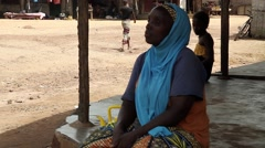 Africa native village -  woman staring at the street Stock Footage