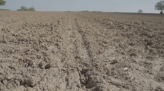 Ploughed Dry Field Ready For sowing Seedes And A Drop Of Rain - stock footage