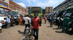 Street scene in bus park in the Kampala, Uganda. Stock Footage
