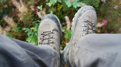 Dirty hiking Boots Fly Above The Ground Stock Footage