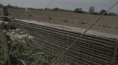 Along A Wooden Fence With Barbed Wire - stock footage