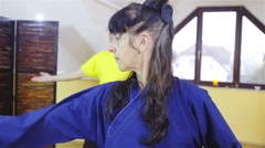 Woman in kimono showing learner of shaolin forms indoors 4K Stock Footage