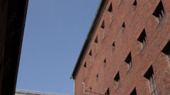 Exterior view of the facade of a red brick building Stock Footage