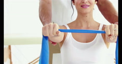 Pregnant woman working out with instructor Arkistovideo