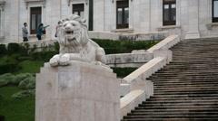 Lion statue, Portuguese parliament steps, Lisbon Lisboa, Portugal Stock Footage