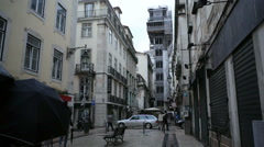 Santa Justa Lift, small street, long shot, tilt up, Lisbon, Lisboa, Portugal Stock Footage