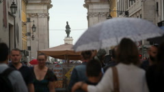 Crowd people walk with umbrellas, Augusta Street, Lisbon, Lisboa, Portugal - stock footage