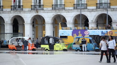 Rickshaw taxis, tourist bus, Praca do Comercio, commerce square, Portugal - stock footage