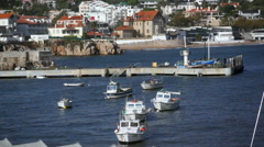 Small anchored boats, Cascais marina port harbor, jetty, Portugal Stock Footage