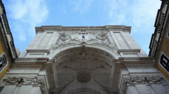 View under Rua Augusta Arch clock, tilt down to street, Lisbon, Portugal - stock footage