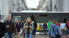 Pedestrian people crowd walk down busy street, Lisbon, Lisboa, Portugal Stock Footage