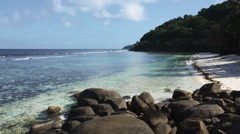 Stock Video Footage of Seychelles beach with blue ocean view with big stones