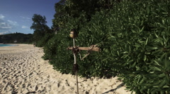 Seychelles beach with blue ocean view with funny scarecrow Stock Footage