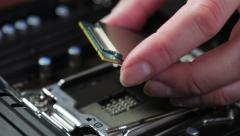 Cpu in hand and motherboard Stock Footage
