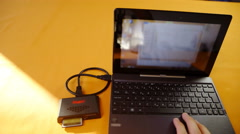 Laptop computer with card reader plugged 4K Stock Footage