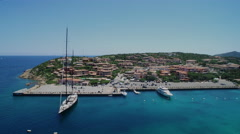 Sailboat harbor in Sardinia from drone - stock footage