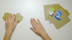 Person start folding origami paper on table 4K Stock Footage
