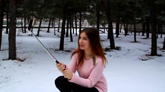 Young girl selfe on the phone in the park outdoors - stock footage
