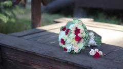 Wedding bouquet on the well - stock footage