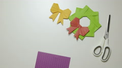 Folding purple origami paper on table 4K Stock Footage