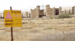 Terrain around Jordan with Danger Mines sign next to Israel border Stock Footage