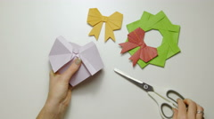 Cutting origami paper while folding 4K Stock Footage