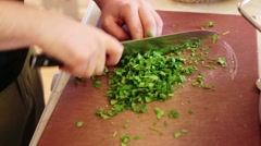 Cutting and grinding parsley to cook an indian lunch Stock Footage