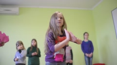 Little Girl  dancing Hip Hop in front of other children in the kindergarden Stock Footage