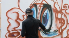 Man painting graffiti Stock Footage