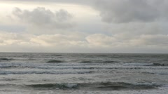 Panoramic dolly shot of stormy waving sea slow motion Stock Footage