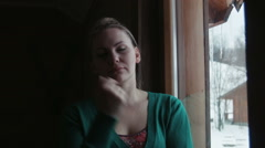 Portrait of the smiling woman near a window Stock Footage