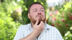 A man with a beard wearing a white shirt Stock Footage