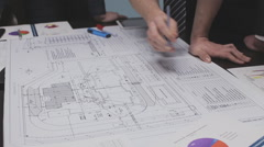 Engineers read drawing and discuss the project Stock Footage