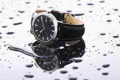 Wristwatches on a light background acrylic - stock photo