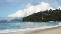 Seychelles beach with blue ocean view. With hotel houses. Stock Footage