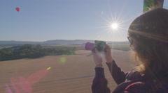 Woman films beautiful scenery - stock footage