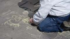 Little child drawing with chalk outdoor - stock footage