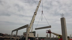 Mobile crane is operating, assembly concrete joist. Stock Footage