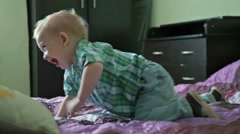 little boy have fun in bed - stock footage