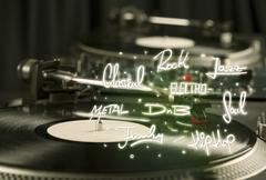 Turntable with vinyl and music genres writen Stock Photos