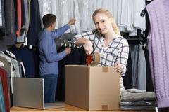 Couple Running Online Clothing Store Packing Goods For Dispatch - stock photo