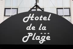 Hotel sign of the beach under the building - stock photo