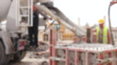 Blurred view at pouring concrete in reinforced mold. Stock Footage