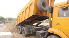 Dump truck is unloading soil. Stock Footage