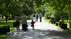 People in green sunny park Stock Footage