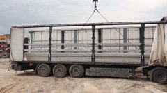 Mobile crane is unloading concrete joist from truck trailer. Stock Footage
